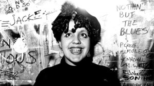 Photo of Poly Styrene, lead singer of punk band X Ray Spex