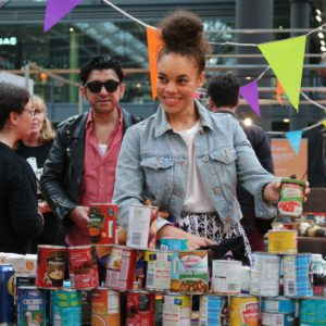 smiling film festival attendee donating food for First Love Foundation